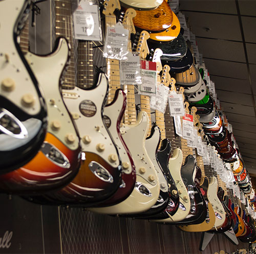 Guitars Hanging on Racks for Sale